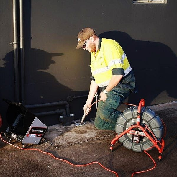 plumber with drain inspection camera